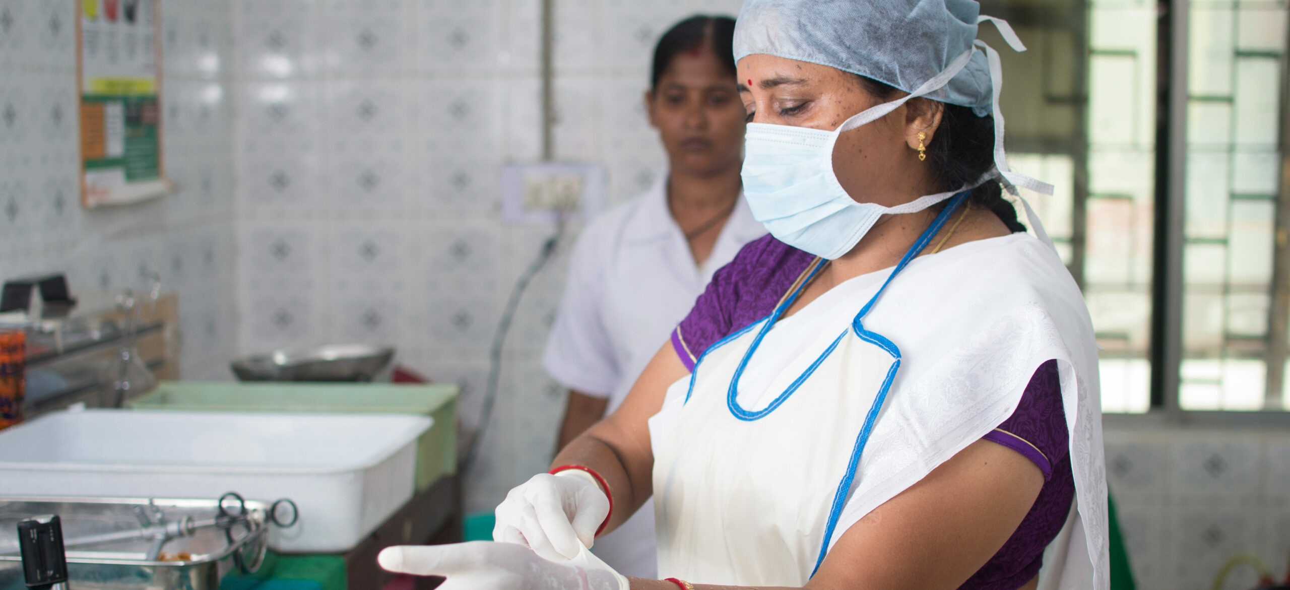 India/City Hospital- Cuttack: Following infection prevention protocols is at the center of establishing quality FP services. Here a staff nurse prepares for a tubal ligation procedure.